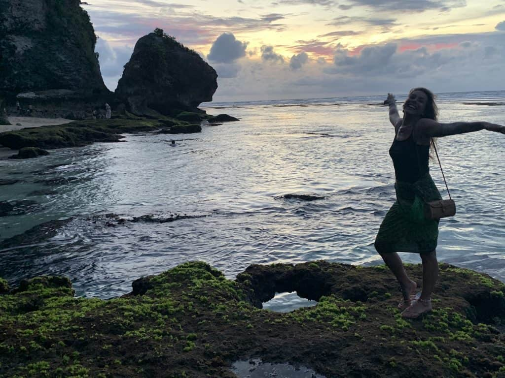 sunset in Bali Indonesia with girl