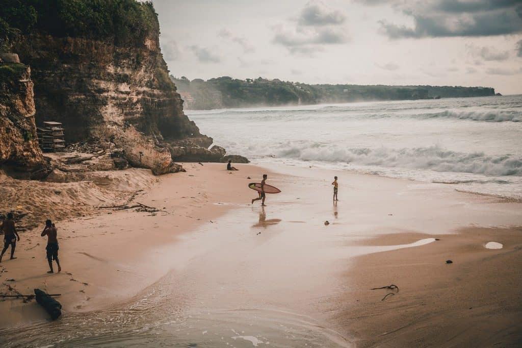 surfers in uluwatu beach
