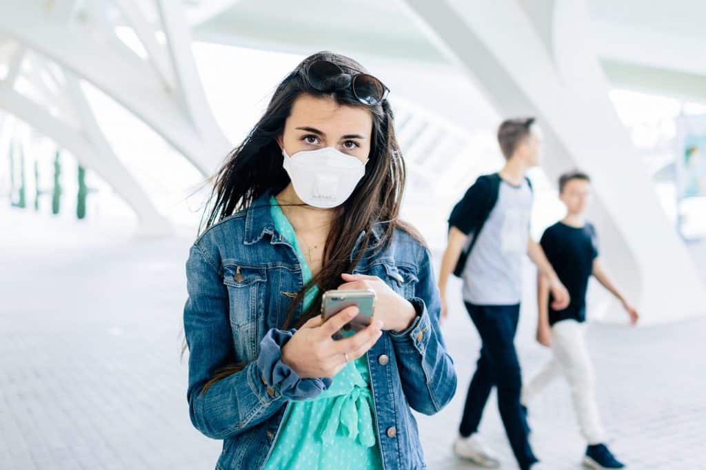 Girl wearing mask while walking to prevent covid-19